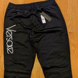 Men's Versace Logo Embroidered jogger pants.